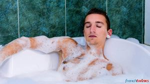 Young boy Justin relaxes quietly in a bubble bath when Baptiste Garcia joins him in the bathroom. 12